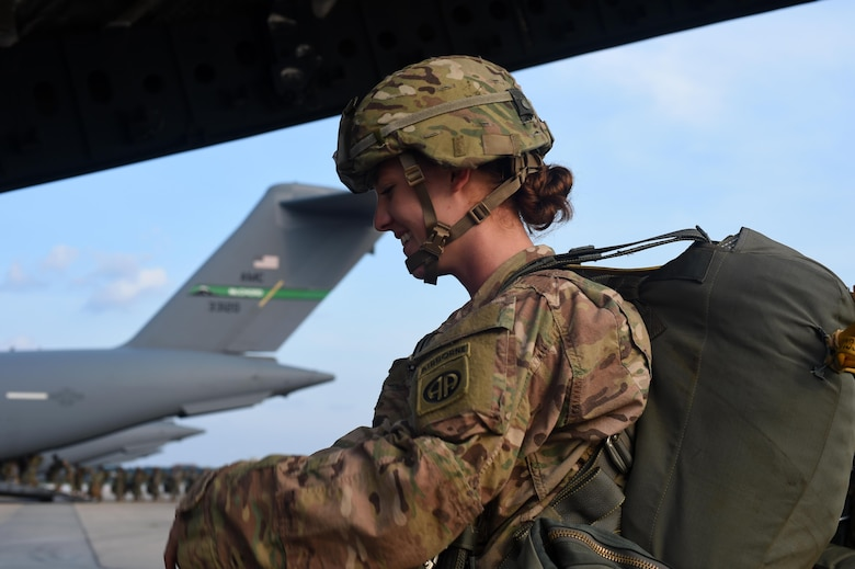 An 82nd Airborne Division Soldier boards a C-17 Globemaster III at Pope Army Air Field, North Carolina, June 4, 2016. Hundreds of Soldiers with the 82nd Airborne Division conducted a static line jump out of seven C-17s including three from Joint Base Lewis-McChord, Washington and from Joint Base Charleston, S.C. (U.S. Air Force photo/ Staff Sgt. Naomi Shipley)