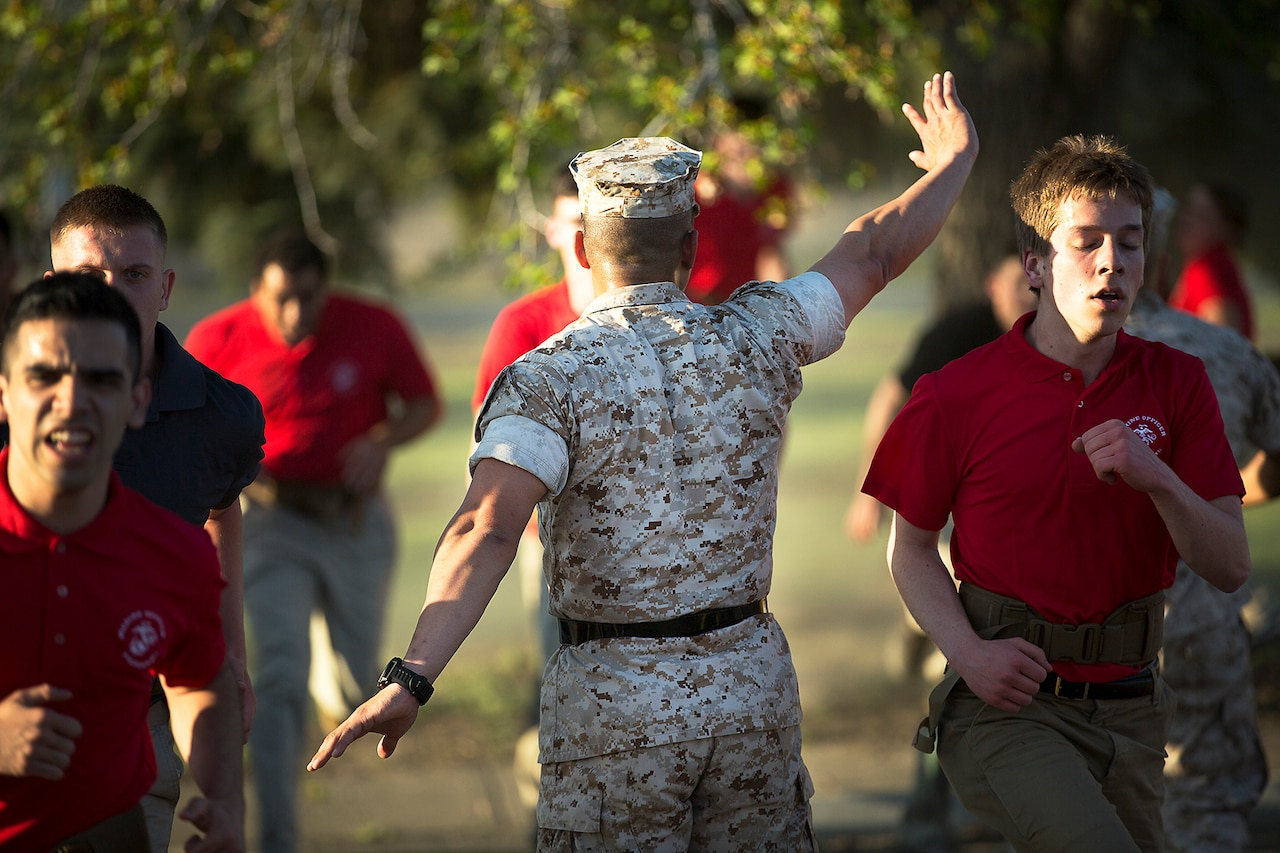 Marine Corps Staff Sgt. Keun Chung, a sergeant instructor at the Marine Corps Officer Candidates School, instructs officer candidates during an OCS preparation event at the Yakima Training Center in Yakima, Wash., April 8, 2016. Defense Secretary Ash Carter today announced proposed changes to the promotion rules for military officers in all services. Marine Corps photo by Sgt. Reece Lodder
