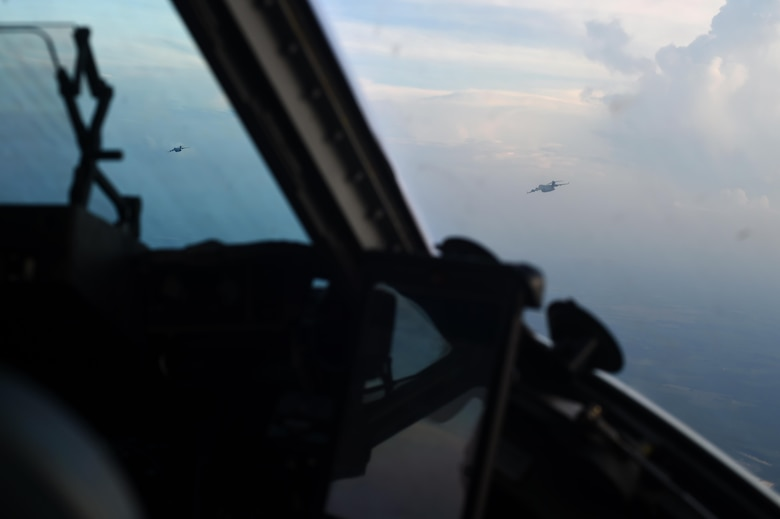 Two 62nd Airlift Wing C-17 Globemaster III aircraft fly over the Pope Army Air Field Range, North Carolina, June 4, 2016. Three C-17's from Joint Base Lewis-McChord, Wash., stopped at Pope to conduct air drop training with the 82nd Airborne Division, Fort Bragg N.C. prior to participating in Exercise Swift Response. (U.S. Air Force photo/Staff Sgt. Naomi Shipley)