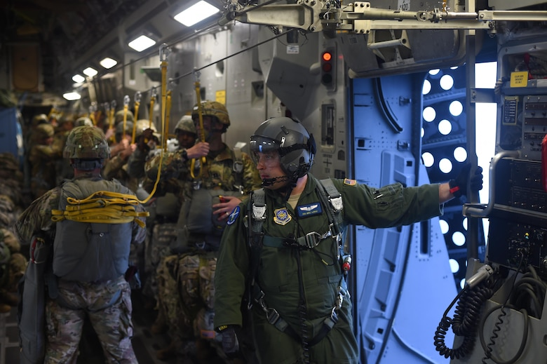 Senior Airman Mike Longo, 7th Airlift Squadron C-17 loadmaster, prepares for a personnel air drop over the Pope Army Air Field Range, North Carolina, June 4, 2016. Longo was one of three loadmasters on the aircraft ensuring the 90 Soldiers conducted a safe static line jump. (U.S. Air Force photo/Staff Sgt. Naomi Shipley)