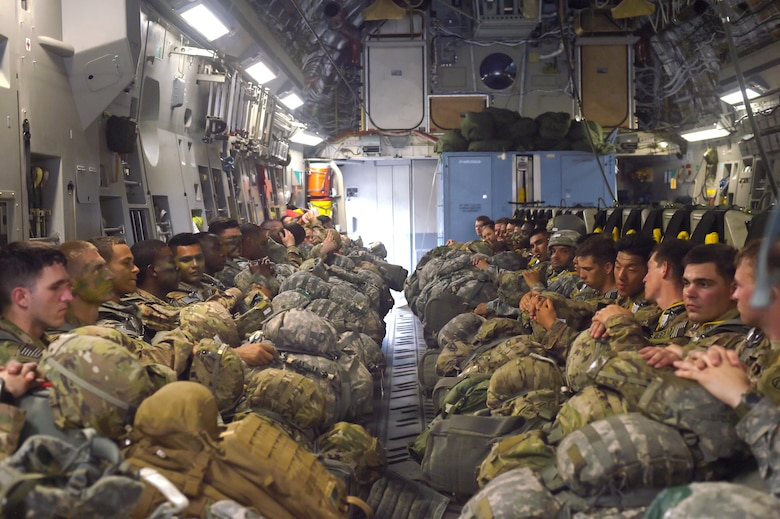 Soldiers with the 82nd Airborne Division sit inside a 62nd Airlift Wing C-17 Globemaster III at Pope Army Air Field, North Carolina, June 4, 2016. More than 90 Soldiers boarded the C-17 to conduct a static line parachute jump over the range. (U.S. Air Force photo/Staff Sgt. Naomi Shipley)