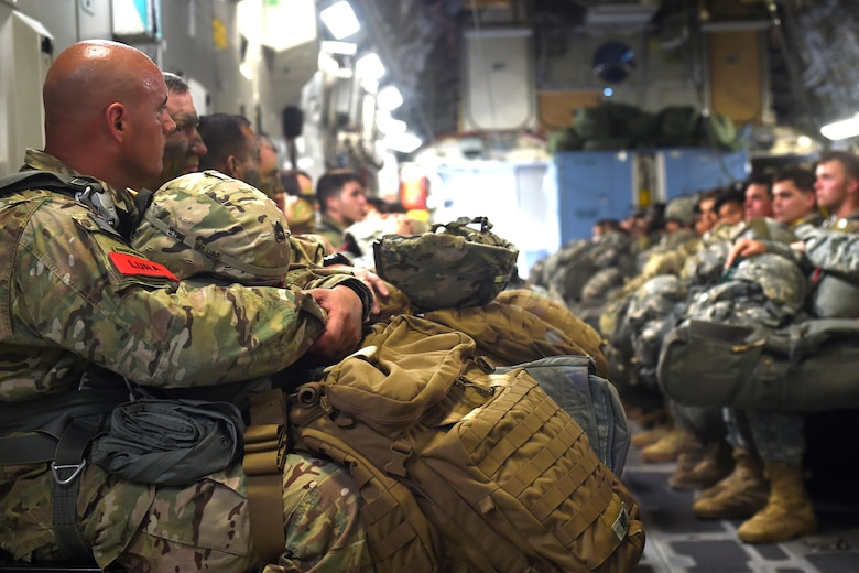 82nd Airborne Soldiers prepare to jump out of a C-17 Globemaster III at Pope Army Air Field, North Carolina, June 4, 2016. Seven C-17's loaded approximately 90 Soldiers to conduct a personnel air drop over the range for training prior to departing for a large scale exercise in Europe. (U.S. Air Force photo/Staff Sgt. Naomi Shipley)