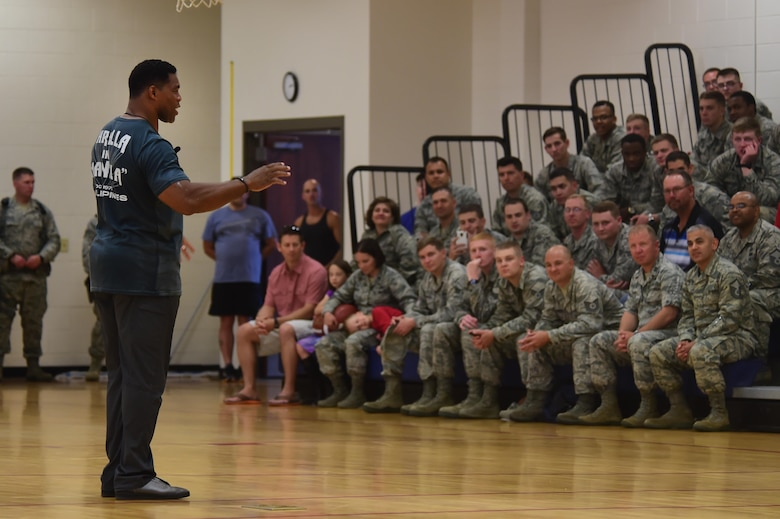 Herschel Walker, former National Football League running back, speaks to an audience June 8, 2016, at the fitness center on Buckley Air Force Base, Colo. Walker spoke about his professional sports career and other business ventures he has been involved with. (U.S. Air Force photo by Airman 1st Class Luke W. Nowakowski/Released)