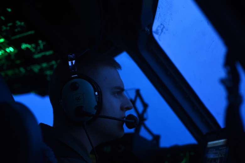 1st Lt. Patrick Schiess, 7th Airlift Wing C-17 Globemaster III pilot flys over the Pope Army Air Field Range, North Carolina on June 4, 2016. Schiess was one of three air crews from Joint Base Lewis-McChord, Wash., working with four other C-17 air crews conducting air drops for training. (U.S. Air Force photo/ Staff Sgt. Naomi Shipley)