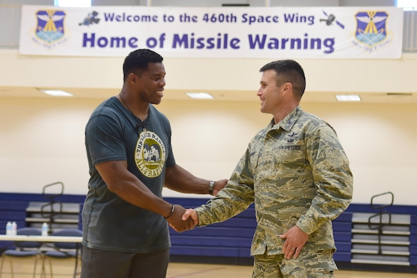 Col. John Wagner, 460th Space Wing commander, thanks Herschel Walker, former National Football League running back, for visiting the installation June 8, 2016, at the fitness center on Buckley Air Force Base, Colo. Walker visited Buckley to speak about his appreciation for military members and the struggles he's had to overcome. (U.S. Air Force photo by Airman 1st Class Luke W. Nowakowski/Released)