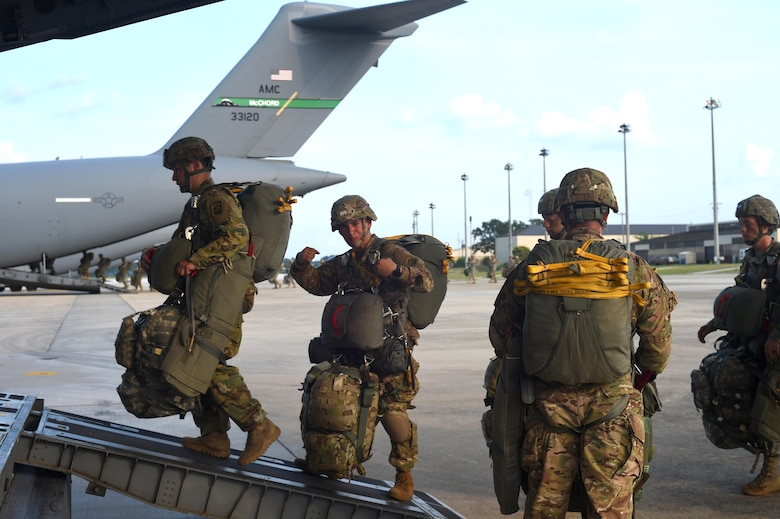 Soldiers with the 82nd Airborne Division board a 62nd Airlift Wing C-17 Globemaster III at Pope Army Air Field, North Carolina, June 4, 2016. More than 90 Soldiers boarded three C-17's from Joint Base Lewis-McChord, Washington. (U.S. Air Force photo/Staff Sgt. Naomi Shipley)