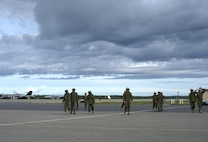 U.S. Marine Corps Marines assigned to the Fixed Marine All-Weather Fighter Attack Squadron 242, Marine Corps Air Station Iwakuni, Japan, after ensuring jets safely took off, June 7, 2016, during Red Flag-Alaska (16-2), Eielson Air Force Base, Alaska. RF-A provides training for deployed maintenance and support personnel in sustainment of large-force deployed air operations. (U.S. Air Force photo by Airman Isaac Johnson)