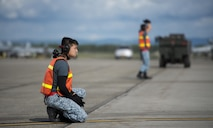 Republic of Singapore Air Force (RSAF) maintainers assigned to Luke Air Force Base, Ariz., wait to marshal incoming RSAF F-16 Fighting Falcons after a RED FLAG-Alaska (RF-A) 16-2 morning sortie June 7, 2016, on the Eielson Air Force Base, Alaska, flight line. RF-A is a Pacific Air Forces commander-directed field training exercise for U.S. and allied forces, to provide joint offensive counter-air, interdiction, close air support and large force employment training in a simulated combat environment. (U.S. Air Force photo by Capt. Elias Zani/Released)