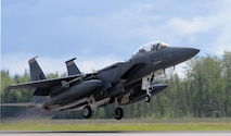 A U.S. Air Force F-15E Strike Eagle all-weather, highly maneuverable, dual-role fighter assigned to the 494th Fighter Squadron out of Royal Air Force Lakenheath, England, gains speed as it lifts off from the Eielson Air Force Base, Alaska, runway June 6, 2016, during RED FLAG-Alaska (RF-A) 16-2. RF-A missions are conducted over the Joint Pacific Alaska Range Complex, more than 67,000 square miles of airspace that includes one conventional bombing range and two tactical bombing ranges containing 510 different types of targets and 45 threat simulators, providing units like the Liberty Wing a realistic training environment in the largest instrumented air, ground and electronic combat training range in the world. (U.S. Air Force photo by Master Sgt. Karen J. Tomasik/Released)