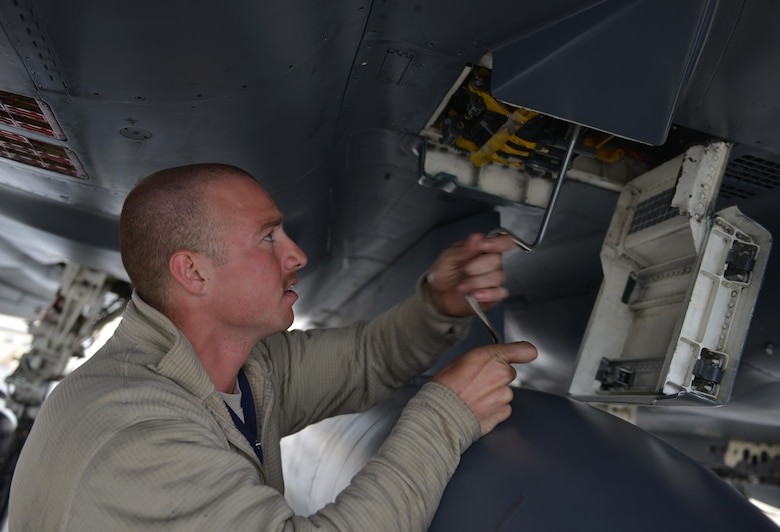 U.S. Air Force Airman 1st Class Zachary Suttles, a crew chief assigned to the 494th Aircraft Maintenance Unit out of Royal Air Force Lakenheath, England, performs maintenance on an F-15E Strike Eagle dual-role fighter aircraft June 8, 2016, during RED FLAG-Alaska (RF-A) 16-2 at Eielson Air Force Base, Alaska. RF-A is a Pacific Air Forces commander-directed field training exercise for U.S. and allied forces, providing joint offensive counter-air, interdiction, close air support, and large force employment training in a simulated combat environment. (U.S. Air Force photo by Airman Isaac Johnson)
