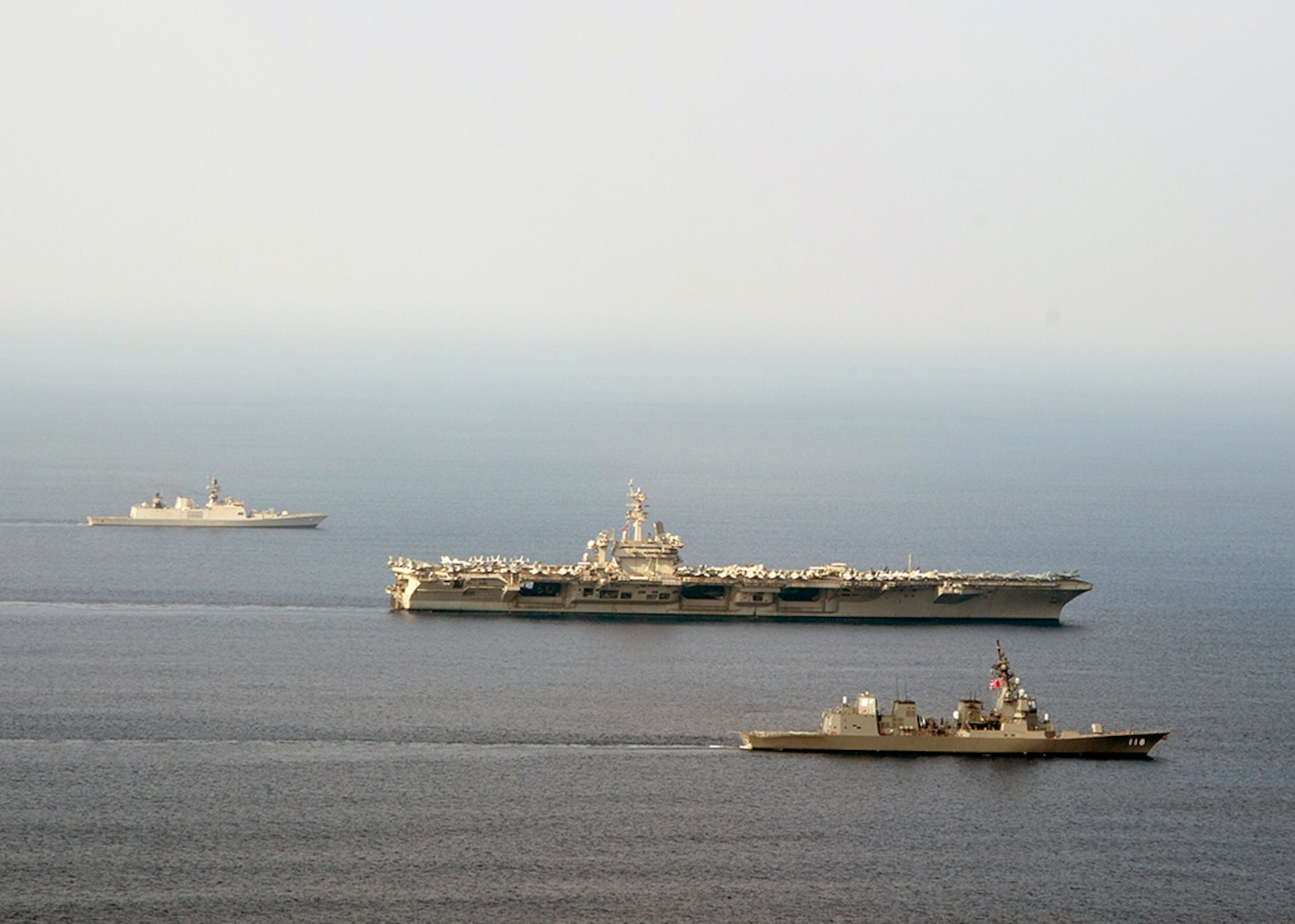 U.S. Navy official File Photo: INDIAN OCEAN (Oct. 16, 2015) The aircraft carrier USS Theodore Roosevelt (CVN 71), Japanese Maritime Self-Defense destroyer Fuyuzuki and Indian Shivalik-class frigate Shivalik transit into formation during a photo exercise as a part of Exercise Malabar 2015. Malabar is a continuing series of complex, high-end war fighting exercises conducted to advance multi-national maritime relationships and mutual security. Theodore Roosevelt is operating in the U.S. 7th Fleet area of operations as part of a worldwide deployment en route toits new homeport in San Diego to complete a three-carrier homeport shift.