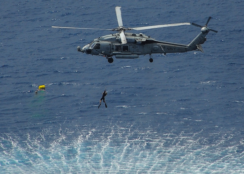 U.S. Navy File Photo: INDIAN OCEAN (Oct. 17, 2015) Explosive Ordnance Disposal (EOD) Mobile Unit Six, platoon 621, conducts a mine exercise during Exercise Malabar 2015. Malabar is a continuing series of complex, high-end war fighting exercises conducted to advance multi-national maritime relationships and mutual security. Theodore Roosevelt is operating in the U.S. 7th Fleet area of operations as part of a worldwide deployment en route to its new homeport in San Diego to complete a three-carrier homeport shift.