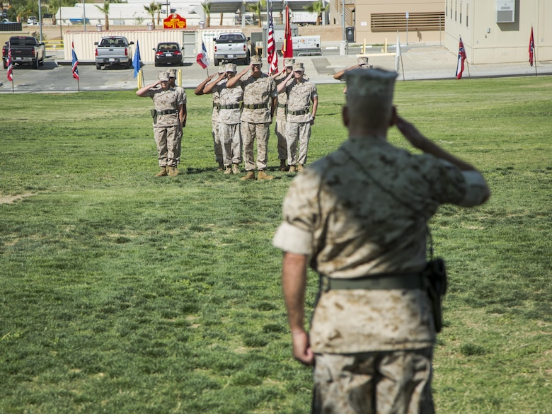 Lt. Col. Dennis A. Sanchez, outgoing battalion commander, Headquarters Battalion, salutes battalion staff during the battalion's change of command ceremony at Lance Cpl. Torrey L. Gray Field aboard the Marine Corps Air Ground Combat Center Twentynine Palms, Calif., June 8, 2016. During the ceremony, Sanchez relinquished command of Headquarters Battalion to Lt. Col. Michael Cable. (Official Marine Corps photo by Lance Cpl. Levi Schultz/Released)