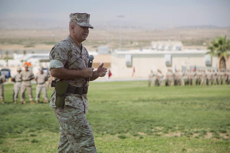Lt Col. Dennis A. Sanchez, outgoing battalion commander, Headquarters Battalion, thanks the Marines and sailors of Headquarters Battalion during the battalion's change of command ceremony at Lance Cpl. Torrey L. Gray Field aboard the Marine Corps Air Ground Combat Center Twentynine Palms, Calif., June 8, 2016. During the ceremony, Sanchez relinquished command of Headquarters Battalion to Lt. Col. Michael Cable. (Official Marine Corps photo by Lance Cpl. Levi Schultz/Released)