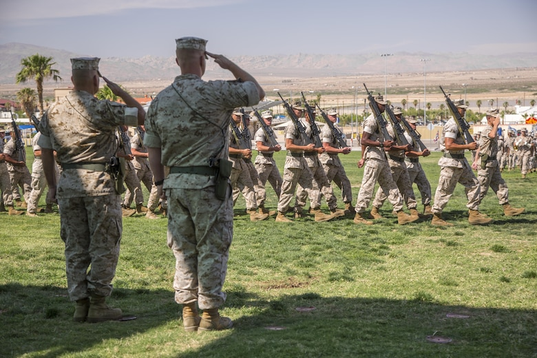 Lt. Col. Dennis A. Sanchez, left, outgoing battalion commander, Headquarters Battalion, and Lt. Col. Michael Cable, right, oncoming battalion commander, Headquarters Battalion, salute Headquarters Battalion Marines during pass in review as part of the battalion's change of command ceremony at Lance Cpl. Torrey L. Gray Field aboard the Marine Corps Air Ground Combat Center Twentynine Palms, Calif., June 8, 2016. During the ceremony, Sanchez relinquished command of Headquarters Battalion to Cable. (Official Marine Corps photo by Lance Cpl. Levi Schultz/Released)