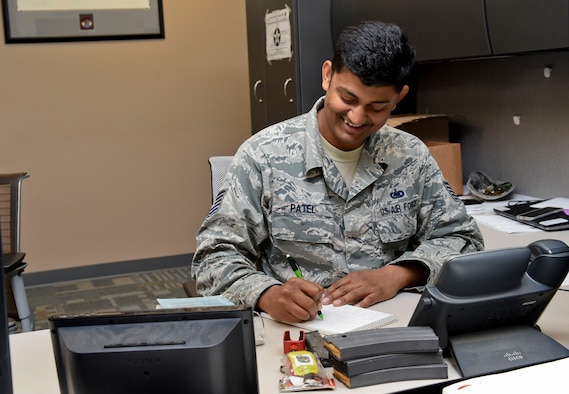 Tech. Sgt. Jignesh Patel, 821st Contingency Response Squadron unit equipment monitor, goes through M-16 magazines and blank-firing adaptors at Travis Air Force Base, Calif., June 7, 2016. Patel oversees all the equipment for the 821st CRS and when they are tasked with an assignment, he ensures the equipment they are taking is accounted for and serviceable. (U.S. Air Force photo by Staff Sgt. Robert Hicks)