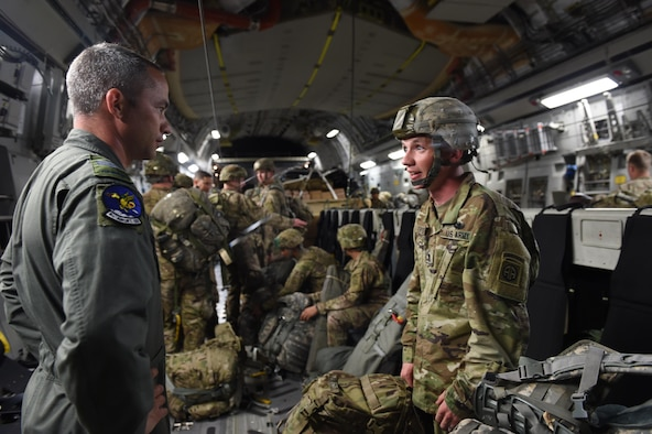 Royal Canadian Air Force Sgt. Wes Ramsay, 8th Airlift Squadron loadmaster, speaks to Army SPC. Dakota Truscott, 82nd Airborne Division, on a 62nd Airlift Wing C-17 Globemaster III at Pope Army Air Field, N.C., on June 6, 2016. Ramsay, who was participating in Exercise Swift Response, is part of an Air Force exchange program at Joint Base Lewis-McChord, Wash., and has worked at McChord for two years. (Air Force photo/Staff Sgt. Naomi Shipley)