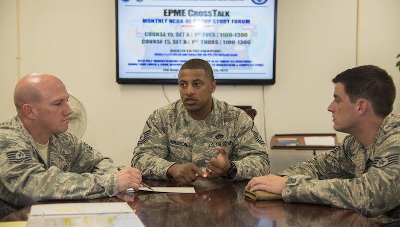 U.S. Air Force Master Sgt. Daniel Robinson, the 35th Force Support Squadron career assistance advisor, counsels participants of the Enlisted Professional Military Education CrossTalk, at Misawa Air Base, Japan, June 9, 2016. The study session is held the first Tuesday and Thursday of every month at the Professional Development Center, providing a forum for NCOs who haven't taken the Course 15 test to gather and discuss concepts of EPME. (U.S. Air Force photo by Airman 1st Class Jordyn Fetter)