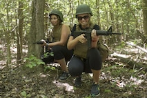 Maria Hetz, left, and Margret Anderson provide security during the patrolling portion of the 2016 Key Leaders and Educators Workshop aboard Marine Corps Base Quantico, Va., June 9. Thirty-nine educators from states east of the Mississippi River participated in activities such as infantry patrolling, flight simulations and many others during the week-long workshop. Hetz is an assistant director of career and professional development at State University of New York Albany. Anderson is an admissions counselor from Bob Jones University, Greenville, S.C.