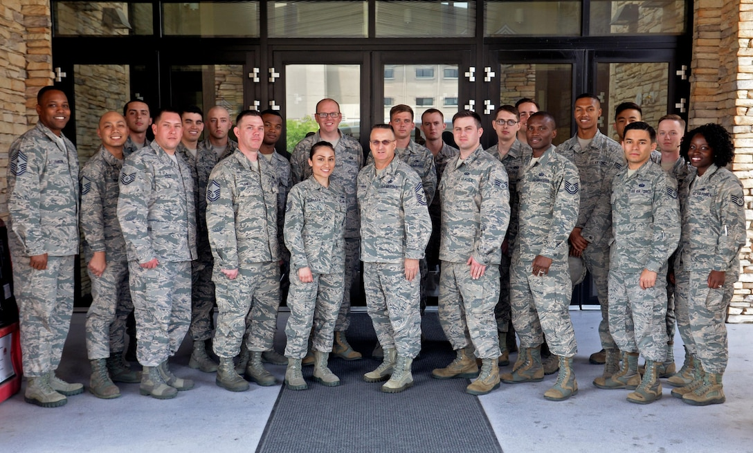 """Chief Master Sgt. Harold. """"Buddy"""" Hutchinson, Pacific Air Forces command chief, meets with Airmen from Osan Air Base, Republic of Korea during his visit to the ROK June 7, 2016. Hutchinson met with Airmen to discuss current topics such as the Weighted Airman Promotion System changes and enlisted professional military education. The chief's visit provided him an overview of 7th Air Force and its tenant units and included a stop at Daejeon to meet with the ROK air force command chief master sergeant to discuss training, partnership enhancement initiatives, and improving combined flying and intelligence, surveillance and reconnaissance operations. As the PACAF command chief master sergeant, Hutchinson leads 45,000 total force Airmen and advises the PACAF commander on matters affecting the readiness, training, professional development and effective use of assigned enlisted personnel. (U.S. Air Force photo by Tech. Sgt. Travis Edwards/Released)"""