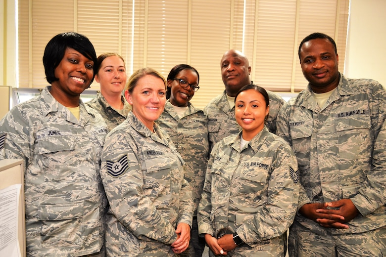 Members of the 111th Force Support Squadron Customer Service Office stand for a picture at Horsham Air Guard Station, Pa., June 8, 2016. Members of an Air National Guard wing customer service office provide cradle-to-grave administrative services for not only all military branches, but also military retirees and dependents. (U.S. Air National Guard photo by Tech. Sgt. Andria Allmond)