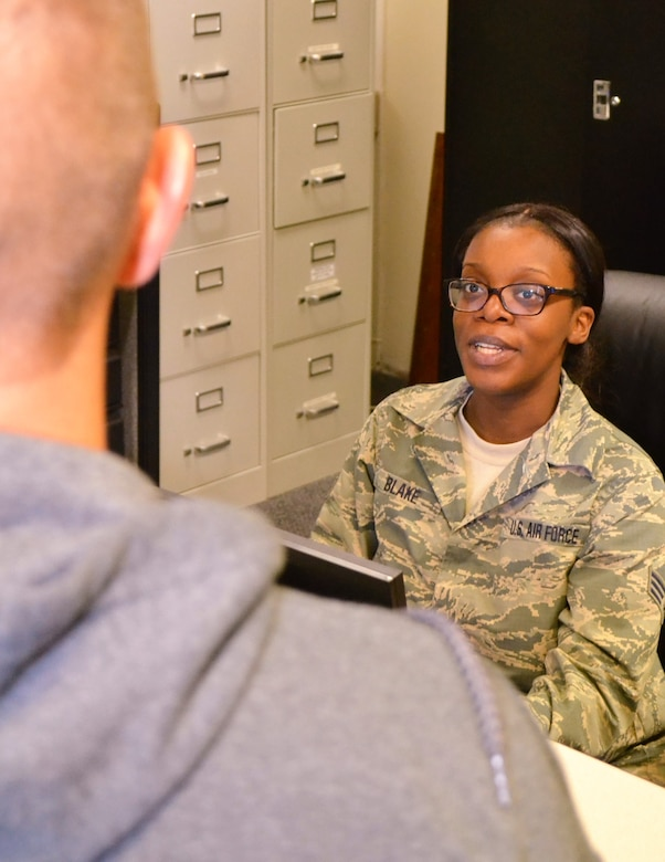 Senior Airman Ameera Blake, a 111th Force Support Squadron customer service specialist, assists a military member with his common access card at Horsham Air Guard Station, Pa, June 8, 2016. Issues dealing with CACs are only one of the many components that encompass the workings of a customer service office in the Air National Guard. (U.S. Air National Guard photo by Tech. Sgt. Andria Allmond)