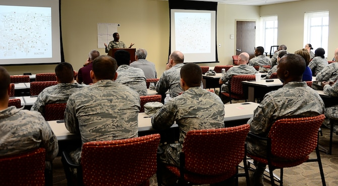 Tech. Sgt. Quanna Charles, a Green Dot representative assigned to the 6th Air Mobility Wing, conducts a one-hour Green Dot Training session on MacDill Air Force Base, Fla., June 8, 2016. The Green Dot program focuses on providing tools and training through activities, open dialogue and a peer-to-peer learning style to create realistic options for preventing violent events. (U.S. Air Force photo by Senior Airman Tori Schultz)