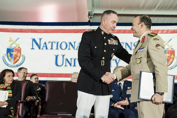 Marine Corps Gen. Joe Dunford, chairman of the Joint Chiefs of Staff, shakes hands with a graduate during the National Defense University's 2016 graduation ceremony at Fort Lesley J. McNair in Washington, D.C., June 9, 2016. The university provides military education to senior leaders of the U.S. armed forces. DoD photo by Army Staff Sgt. Sean K. Harp