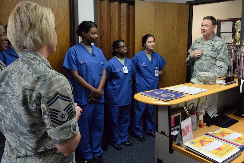 Air Force District of Washington Commander Maj. Gen. Darryl Burke meets members of the 579th Medical Group on Joint Base Anacostia-Bolling, Washington D.C., June 9, 2016.  Gen. Burke visited the Airmen of the dental clinic to present a coin to Senior Master Sgt. Jennifer Klink for her efforts in making 2015 AFDW Annual Awards banquet a memorable event.