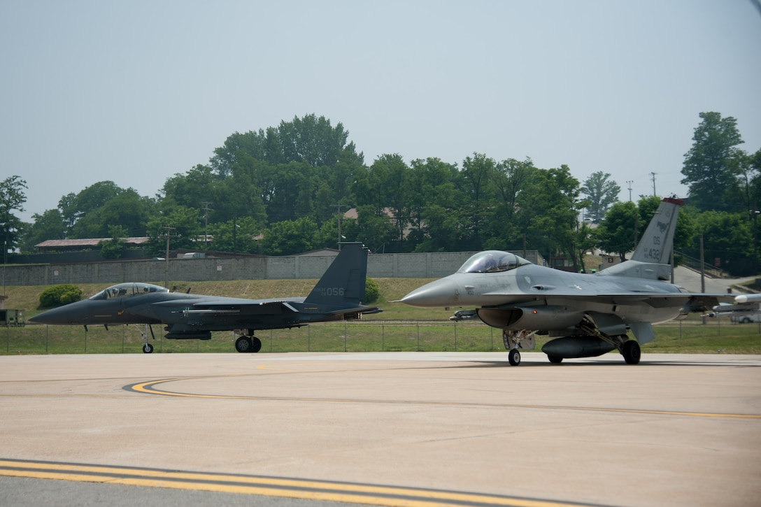 A Republic of Korea air force F-15K Slam Eagle from the 11th Fighter Wing and a U.S. Air Force F-16 Fighting Falcon from the 36th Fighter Squadron line up to take off from Osan Air Base, ROK, June 9, 2016. F-16s and F-15s worked together during Buddy Wing 16-5, which allowed pilots to focus on the fundamentals of air-to-air combat training. (U.S. Air Force photo by Staff Sgt. Jonathan Steffen/Released)