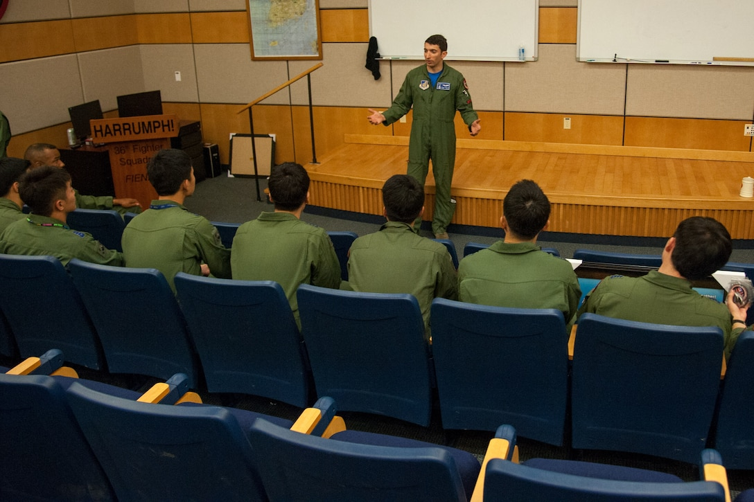 U.S. Air Force Capt. Thomas Nichols, 51st Operation Support Squadron electronic combat pilot, thanks Republic of Korea air force pilots for the training opportunity during Buddy Wing 16-5 at Osan Air Force, Republic of Korea, June 10, 2016. The purpose of the Buddy Wing Program is to execute joint tactics, exchange ideas and improve interoperability between the USAF and ROKAF pilots, maintainers and support personnel. (U.S. Air Force photo by Staff Sgt. Jonathan Steffen)