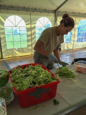 U.S. Air Force Staff Sgt. Krissa Fondakowski, a 104th Fighter Wing member, prepares food as an additional duty in the kitchen tent for Airmen at Graf Ignatievo, Bulgaria, June 3, 2016. Fondakowski is deployed with the 131st Expeditionary Fighter Squadron in support of Operation Atlantic Resolve. (Courtesy Photo by Master Sgt. Adam Casineau/Released)