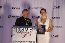 Brigadier Gen. Paul Kennedy presents Kendall Reusing the Excellence in Leadership Award during the U.S. Wrestling Foundation Gala in Los Angeles, June 9, 2016. The Marine Corps advocates for high-achieving student athletes and views this engagement as an opportunity to establish a strong connection with America's youth. Reusing, a Riverside, Calif., native and freshman at Simon Fraser University, was the 2015 California Wrestling State Champion, 2015 United World Wrestling Junior Runner-Up, and was also the 2015 La Sierra High School Valedictorian. Kennedy currently serves as the commanding general of Marine Corps Recruiting Command.