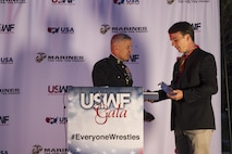 "Brigadier Gen. Paul Kennedy presents Ryan Partridge the Excellence in Leadership Award during the U.S. Wrestling Foundation Gala in Los Angeles, June 9, 2016. The Marine Corps advocates for high-achieving student athletes and views this engagement as an opportunity to establish a strong connection with America's youth. Partridge, a Vienna, Va., native and Madison High School senior, is a multi-sport athlete (football, wrestling, and lacrosse), a member of National Honor Society, and also founder of the ""Early Birds Powerlifting Club"" at Madison High. Partridge plans to attend the University of Virginia and become a member of the NROTC program there. Kennedy currently serves as the commanding general of Marine Corps Recruiting Command."