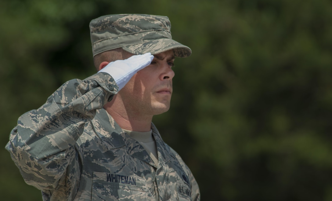 Tech. Sgt. Daniel Whiteman, 786th Force Support Squadron NCO in charge of base honor guard, salutes during a funeral ceremony demonstration as a part of the Air Education and Training Command's Class 5 Basic Protocol, Honors and Ceremonies Course graduation June 9, 2016, at Ramstein Air Base, Germany. Members of the Air Force Honor Guard Mobile Training Team taught the course for Honor Guard Airmen across U.S. Air Forces in Europe. The graduates completed 80 hours of training in pallbearing, firing party, colors and maintenance and wear of the ceremonial uniform. (U.S. Air Force photo/Airman 1st Class Tryphena Mayhugh)