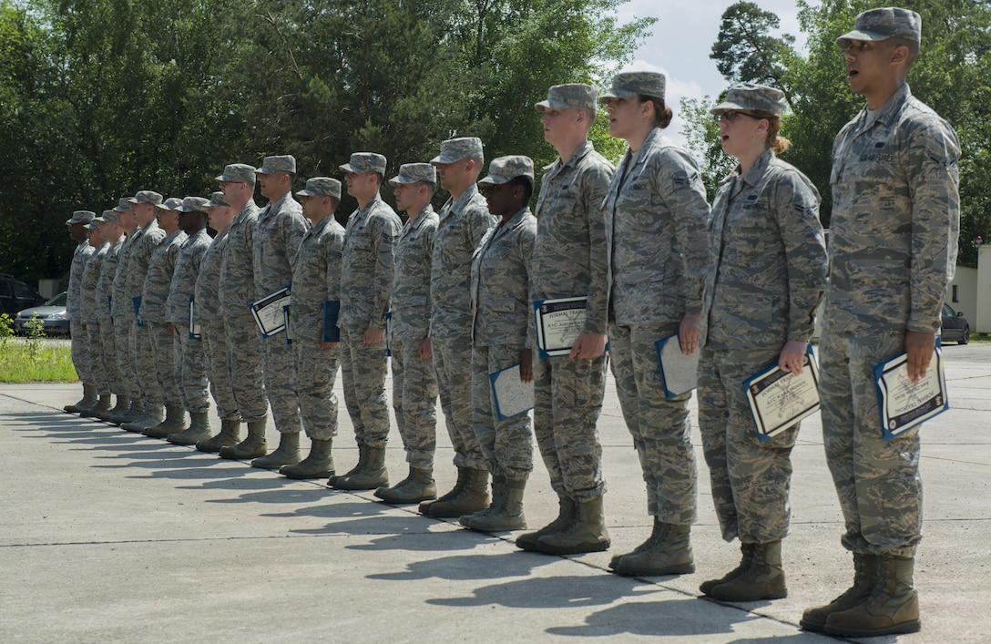 Graduates from the Air Education and Training Command's Class 5 Basic Protocol, Honors and Ceremonies Course recite the Honor Guard Creed after receiving their diplomas June 9, 2016, at Ramstein Air Base, Germany. Members of the Air Force Honor Guard Mobile Training Team taught the course for Honor Guard Airmen across U.S. Air Forces in Europe. The graduates completed 80 hours of training in pallbearing, firing party, colors and maintenance and wear of the ceremonial uniform. (U.S. Air Force photo/Airman 1st Class Tryphena Mayhugh)