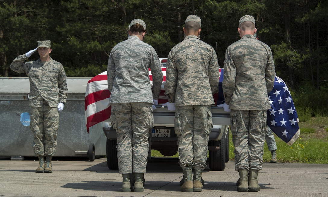 Tech. Sgt. Daniel Whiteman, 786th Force Support Squadron NCO in charge of base honor guard, salutes during a funeral ceremony demonstration as a part of the Air Education and Training Command's Class 5 Basic Protocol, Honors and Ceremonies Course graduation June 9, 2016, at Ramstein Air Base, Germany. Members of the Air Force Honor Guard Mobile Training Team taught the course for Honor Guard Airmen across U.S. Air Forces in Europe. The graduating class consisted of Airmen from Aviano Air Base, Italy; Royal Air Force Station Mildenhall, United Kingdom; Incirlick Air Base, Turkey and Ramstein. (U.S. Air Force photo/Airman 1st Class Tryphena Mayhugh)