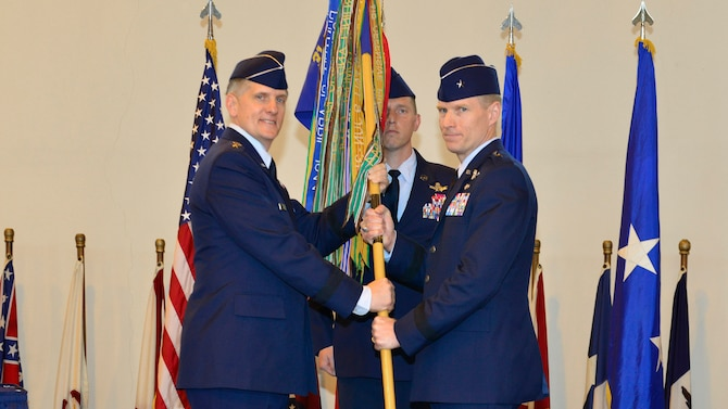 Lt. Gen. Timothy Ray, 3rd Air Force commander, passes the 31st Fighter Wing guidon to Brig. Gen. Lance Landrum during the 31st FW change of command ceremony, June 10, 2016, at Aviano Air Base, Italy. During the ceremony, Landrum became the 14th commander to take command of the 31st FW since it relocated to Aviano, Italy, from Homestead, Fla. (U.S. Air Force photo by Airman 1st Class Cary Smith/Released)