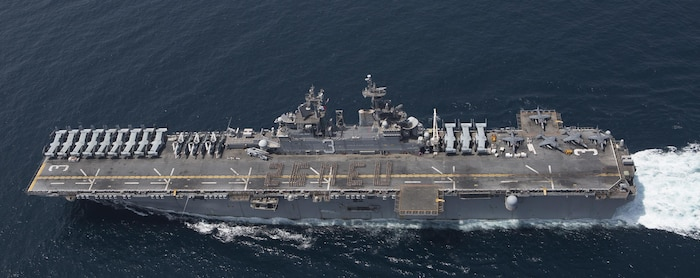 U.S. Marines and Sailors assigned to the 26th Marine Expeditionary Unit (MEU) spell out 26 MEU on the flight deck of the amphibious assault ship USS Kearsarge (LHD 3), Mar.14, 2016 in the Arabian Sea. The 26th MEU is embarked on the Kearsarge Amphibious Ready Group and deployed to maintain regional security in the U.S. 5th Fleet area of operations. (U.S. Marine Corps photo by Gunnery Sgt. Andrew D. Pendracki / 26th MEU Combat Camera / Released)