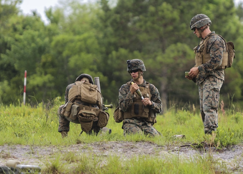 A mortar team with 1st Battalion, 2nd Marine Regiment, 2nd Marine Division, adjusts the mortar to the measurements provided to hit their targets during a training exercise at Camp Lejeune, N.C., June 6, 2016. Marines underwent mortar familiarization and proficiency training in preparation for their upcoming deployment in support of Special-Purpose Marine Air-Ground Task Force. (U.S. Marine Corps photo by Lance Cpl. Aaron K. Fiala/Released)