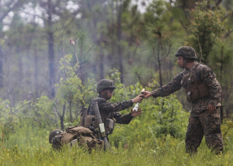 A mortarman with 1st Battalion, 2nd Marine Regiment, 2nd Marine Division, receives a primed mortar round during a training exercise at Camp Lejeune, N.C., June 6, 2016. Marines underwent mortar familiarization and proficiency training in preparation for their upcoming deployment in support of Special-Purpose Marine Air-Ground Task Force. (U.S. Marine Corps photo by Lance Cpl. Aaron K. Fiala/Released)