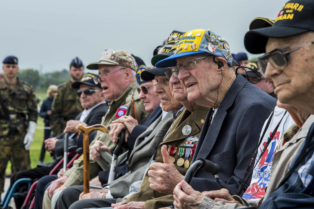 D-Day veterans listen during the Utah Beach Memorial Ceremony in Normandy, France, June 4, 2016. Navy photo by Petty Officer 1st Class Sean Spratt