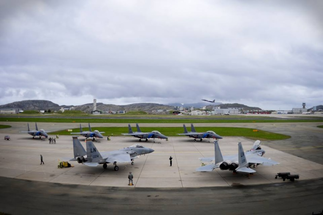 Royal Norwegian Air Force members refuel two 493rd Fighter Squadron F-15C Eagles during training exercise Arctic Fighter Meet 2016 at Bodø Main Air Station, Norway, May 25, 2016. This exercise allowed forward-based U.S. Airmen and aircraft from Royal Air Force Lakenheath to train with NATO allies and other European partners, building on skill sets and improving every nation's ability to seamlessly work together. (U.S. Air Force photo/Senior Airman Erin Babis)