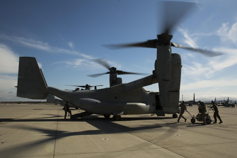 Marines with Marine Medium Tiltrotor Squadron (VMM) 165 inspect an MV-22B Osprey after a training flight aboard Marine Corps Air Station Miramar, Calif., June 8. The training consisted of confined area landings (CAL) and reduced visibility landings (RVL). (U.S. Marine Corps photo by Sgt. Michael Thorn/Released)