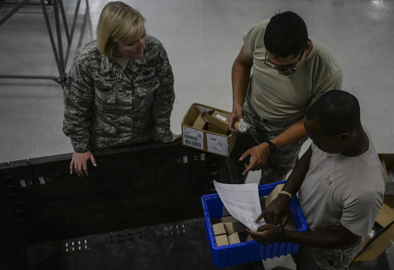Tech. Sgt. Tiffany Larson, 99th Logistics Readiness Squadron NCO in-charge of the F-35 Aircraft Parts Store, works with her Airmen to move F-35 parts from the store's old location into their new building at Nellis Air Force Base, Nev., June 6. The Airmen of the parts store will be moving to a new location and assisting with the school house curriculum in order to help prepare the Air Force to bring the F-35 to Initial Operational Capability. (U.S. Air Force photo by Airman 1st Class Kevin Tanenbaum)