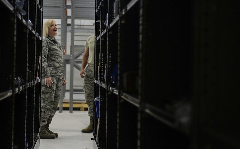 Tech. Sgt. Tiffany Larson, 99th LRS NCO in charge of F-35 aircraft parts store, surveys the shelves of the new location that the F-35 parts store will be working out of at Nellis Air Force Base, Nev., June 6, 2016. With the Air Force's growing F-35 program, it is essential to supply the shops that support the airframe with the facilities necessary to perform at their highest potential. (U.S. Air Force photo by Airman 1st Class Kevin Tanenbaum)