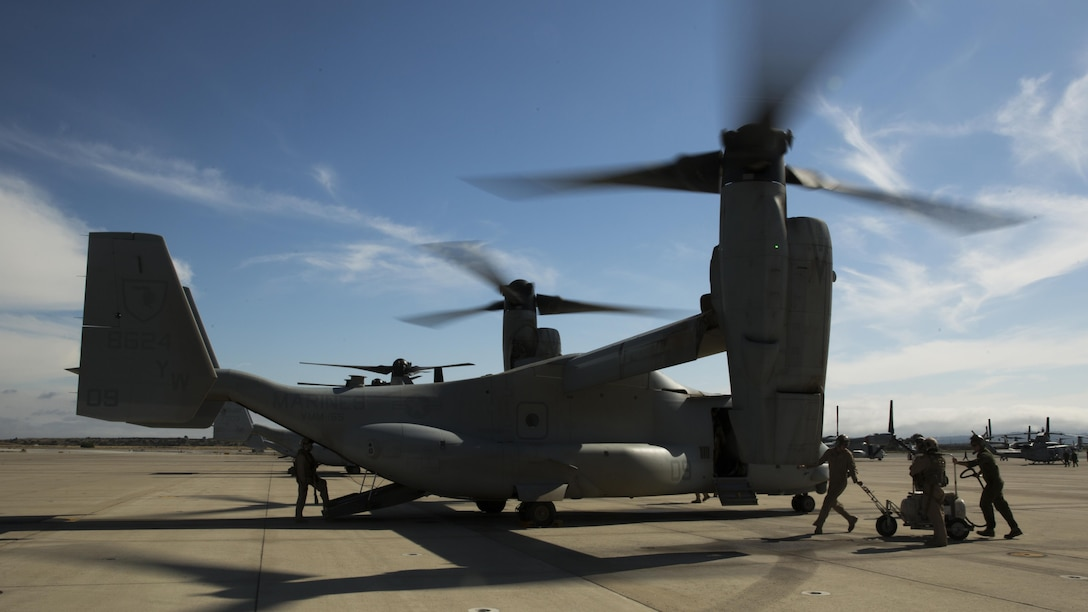Marines with Marine Medium Tiltrotor Squadron 165 inspect an MV-22B Osprey after a training flight at Marine Corps Air Station Miramar, California, June 8. The training consisted of confined area landings and reduced visibility landings.