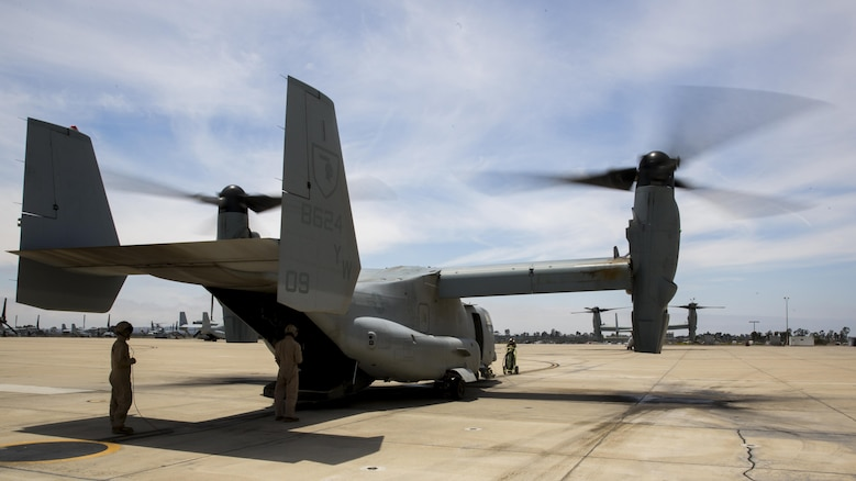 Marines with Marine Medium Tiltrotor Squadron 165 prepare an MV-22B Osprey for a training flight aboard Marine Corps Air Station Miramar, California, June 8. The training consisted of confined area landings and reduced visibility landings.