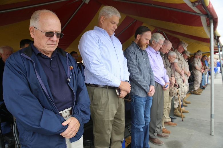 MARINE CORPS BASE CAMP PENDLETON, Calif. – Marines and veterans bow their heads during a rededication ceremony as part of the 1st Combat Engineer Battalion, 1st Marine Division, 75th anniversary at Camp Pendleton May 26, 2016. After touring the area, 1st CEB honored its current unit awards while also recognizing the veterans in attendance who served in some of the notorious battles of old, during World War II, the Vietnam War and the Gulf War.  (U.S. Marine Corps photo by Cpl. Demetrius Morgan/RELEASED)