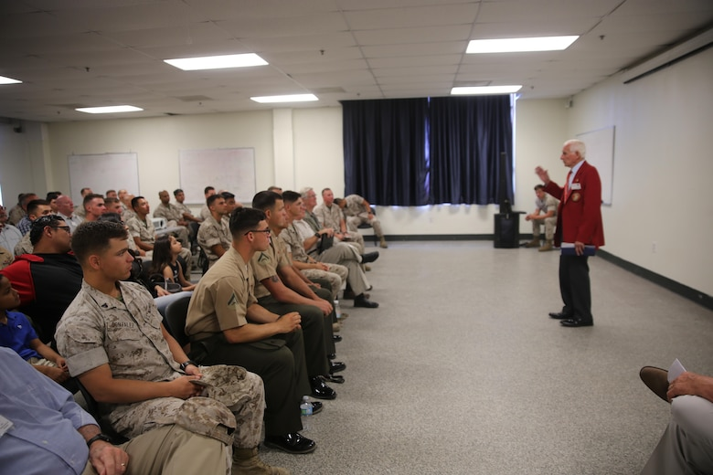 MARINE CORPS BASE CAMP PENDLETON, Calif. – A Marine veteran speaks to current service members about his time in the Marine Corps during the 1st Combat Engineer Battalion, 1st Marine Division, 75th anniversary celebration at Camp Pendleton May 27, 2016. On the second day, veterans were center stage as they presented themselves and their military experiences with the current personnel of 1st CEB. (U.S. Marine Corps photo by Cpl. Demetrius Morgan/RELEASED)